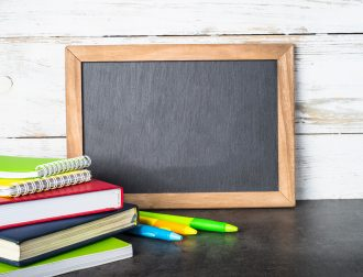Back to school concept. School and office supplies, stationery and chalkboard.